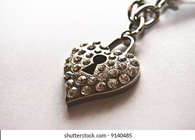 heart shaped necklace made of iron , with a bolt in the middle.