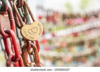 Heart shaped padlock on chain