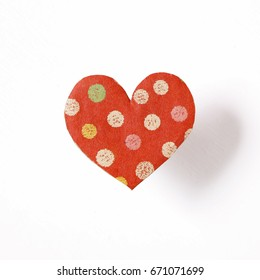 Heart shaped paper on white background