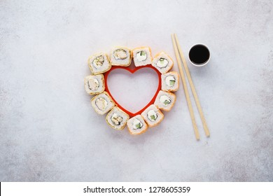 Heart shaped Philadelphia sushi rolls with salmon and cucumber for Valentine's Day.