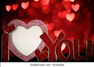Heart shaped photo frame on defocused bokeh background