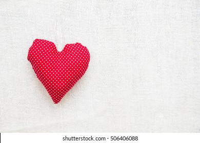 Heart shaped pillow over blank background - text area.
