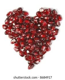 Heart shaped pomegranate seeds, high key, vivid and detailed