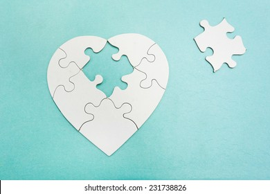 Heart shaped puzzle with missing piece