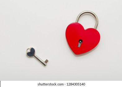 Heart shaped red lock with key. Concept of love forever with padlock