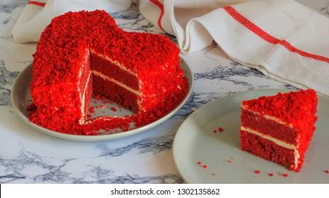 heart shaped red velvet cake on marble table slide aside