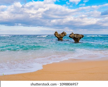 The heart shaped rock is on the Tinu beach on the north side of Kouri Island in Okinawa Prefecture, Japan. Kouri island is a remarkably isolated island where you can cross the Kouri Bridge.