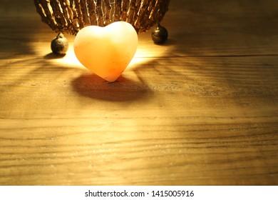 heart shaped rock salt in a wooden background