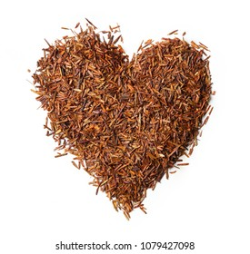 Heart shaped from rooibos tea isolated on white background. Top view. Close up. High resolution
