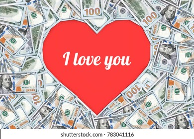 Heart shaped sign made with many 100 dollar banknotes. cash gift for a loved one. inscription I love you. Valentine. 14 Feb, February