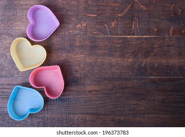 Heart Shaped Silicon Bun Cases on wooden background