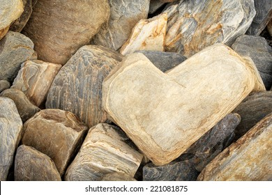 Heart shaped stone among other limestones - Symbol of Eternal Love, Valentine's Day concept
