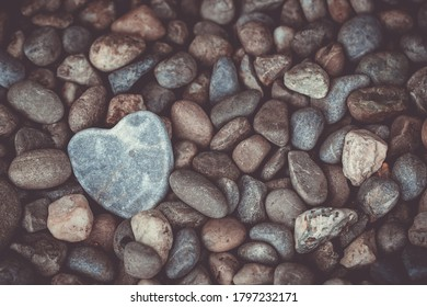 heart shaped stone with pebbles