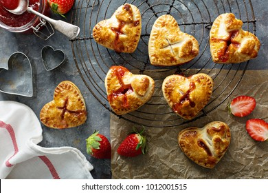 Heart shaped strawberry hand pies, homemade treats for Valentines Day overhead shot