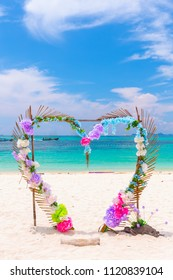 Heart shaped sympathy beautiful flowers backdrop wedding scene on white sand beach.