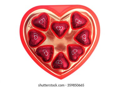 A heart shaped tin of Heart Shaped Milk Chocolates isolated on white with room for text. Valentines Day. Lovers Day, Love, Romance, Hearts and Flowers.