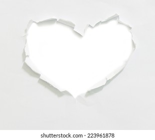 Heart shaped torn paper, isolated on white background.