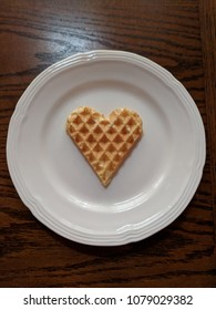Heart shaped waffle on a white plate