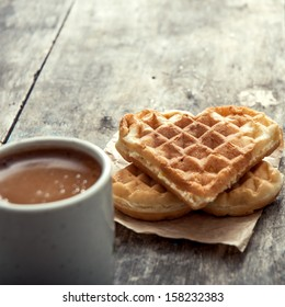 heart shaped waffles and coffee on table
