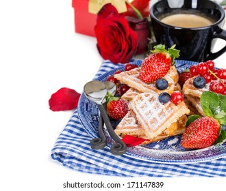 Heart shaped waffles and coffee for romantic breakfast with strawberries, red rose and gift box, valentines day. Over white background, isolated, with copy space.