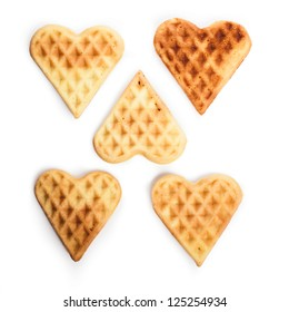 Heart shaped waffles isolated on white background
