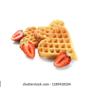 Heart shaped waffles with strawberries on white background