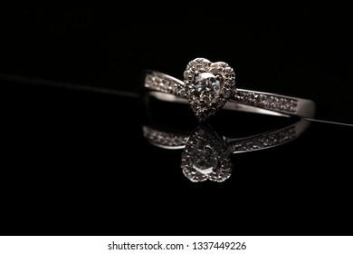 heart shaped wedding diamond ring on black background