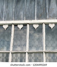 Heart shaped wooden decoration detail on an old house in  rural Rzeszow, Poland.