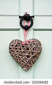 A heart shaped wreath  on a front door