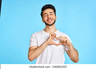 heart sign man smiling