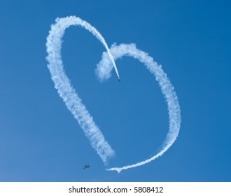 A heart in the sky from skywriting biplanes