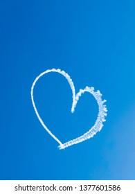 Heart skywriting in blue sky