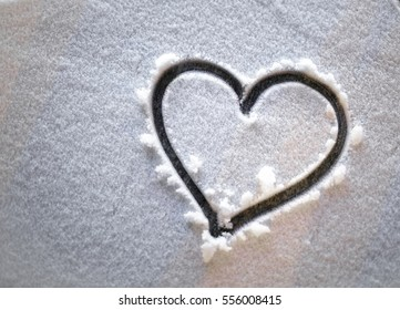 heart in the snow at night.