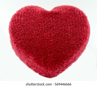 Heart of soft fabric on a white background.