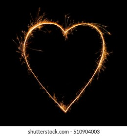heart from sparkler on black background. Bengal fire. Love and Valentine's Day concept