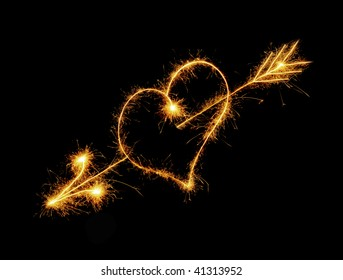 Heart from sparks. It is isolated on a black background