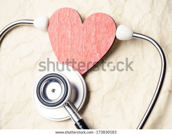 Heart and stethoscope on old paper texture