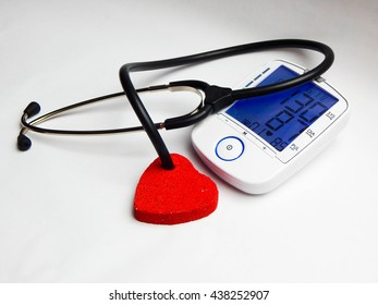 A heart and stethoscope on white background.