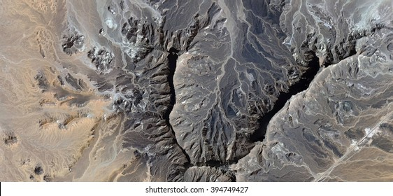 heart of stone,abstract photography of the deserts of Africa from the air, bird's eye view, abstract expressionism, contemporary art, optical illusions,