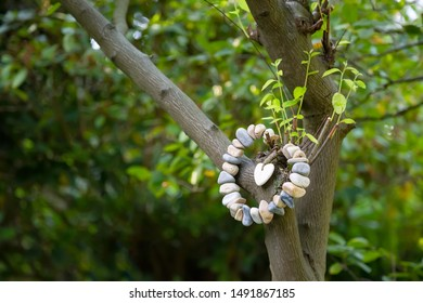 A heart of stones hangs on a tree