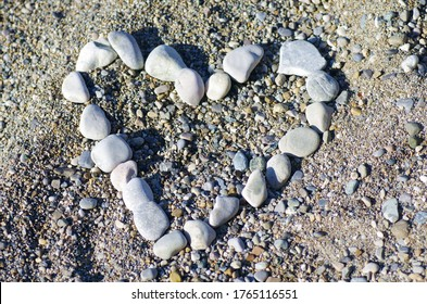 Heart of stones in the sand