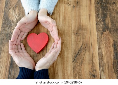 Heart surrounded by couple