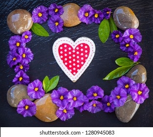 heart surrounded by stones and flowers
