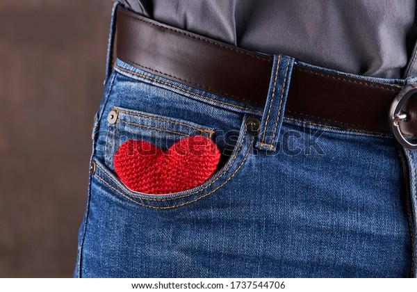 heart symbol at blue jeans pocket. anniversary concept.