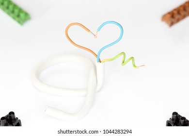 heart symbol with electrical wire on a white background
