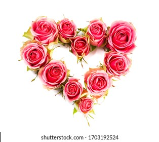 Heart symbol made of fresh pink-red Rose flowers isolated on white background. Love concept for Valentines and Mothers Day.