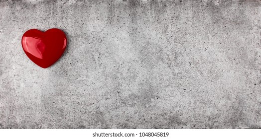 heart symbol on a cement surface