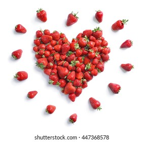 Heart symbol from strawberry isolated on white background. Fruits diet concept. Top view, High resolution product.