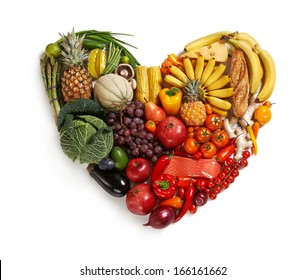Heart symbol / studio photography of heart made from different fruits and vegetables - isolated on white background