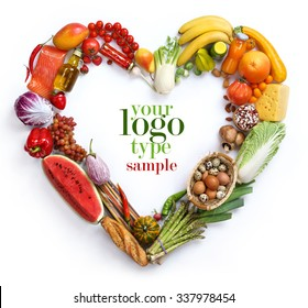 Heart symbol / studio photography of heart made from different fruits and vegetables isolated on white background. High resolution product.